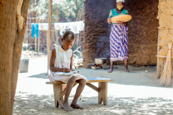Camila, from Mozambique busy studying. She attends Life Child Peace school in Mozambique