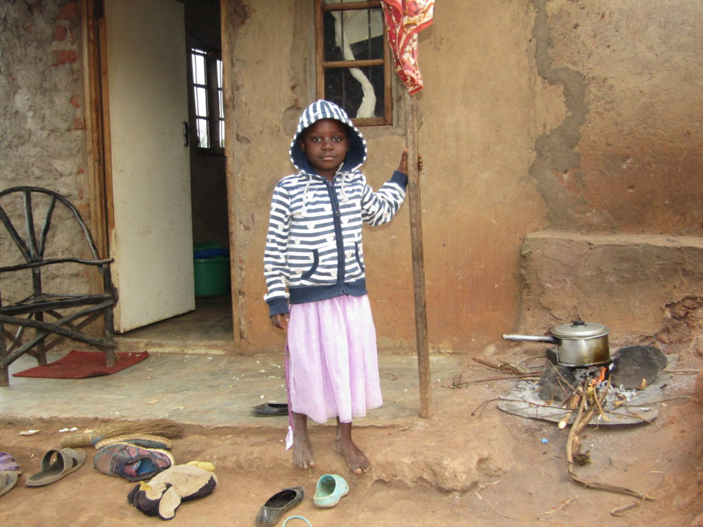 Glory in front of her house. Glory attends Life Child Moyo preschool in Malawi.