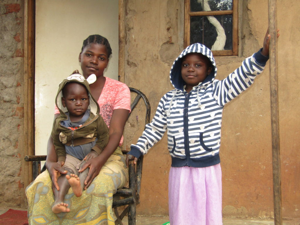 Glory with her mum at their house. Glory attends Life Child Moyo preschool in Malawi.