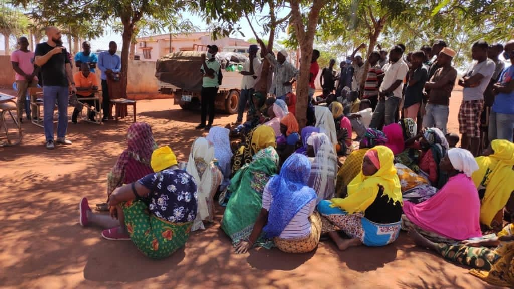 Women sitting under a tree and waiting for an assistance