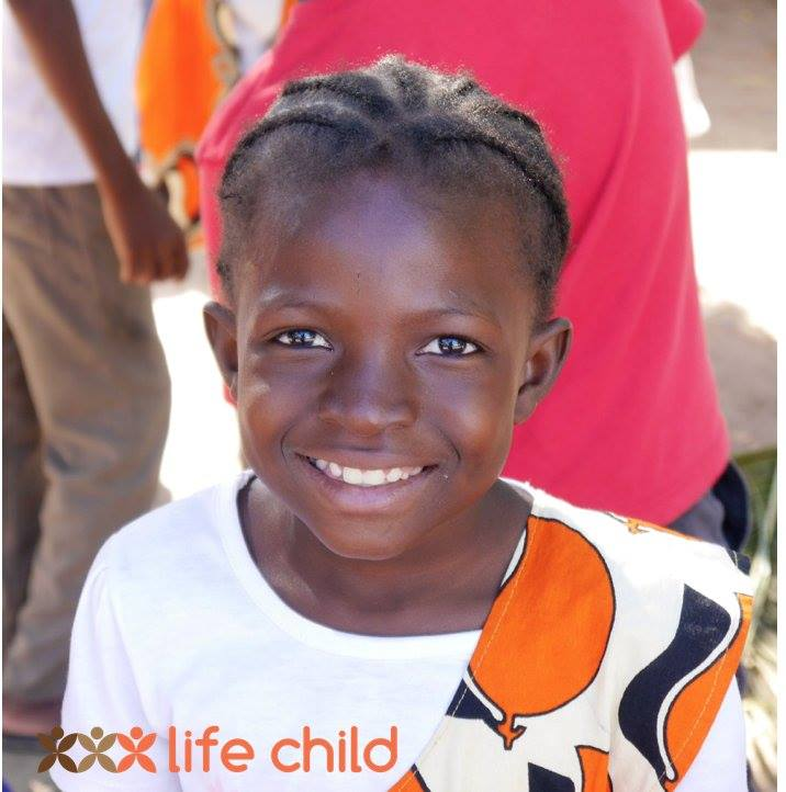 A girl from Life Child school smiling in the camera