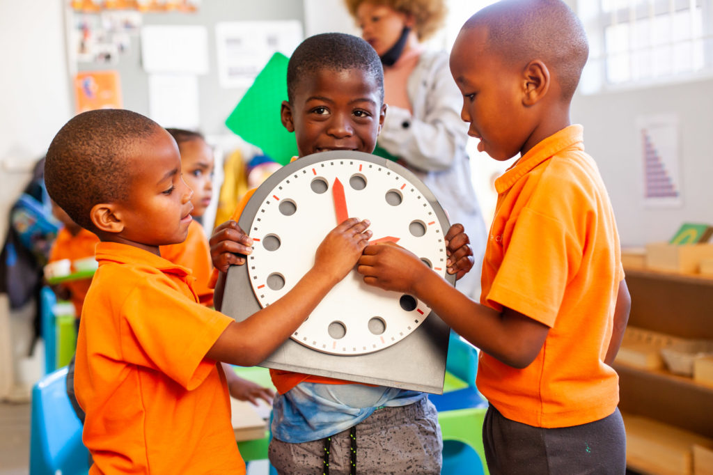 Ndinawe holding a big play clock with his friends