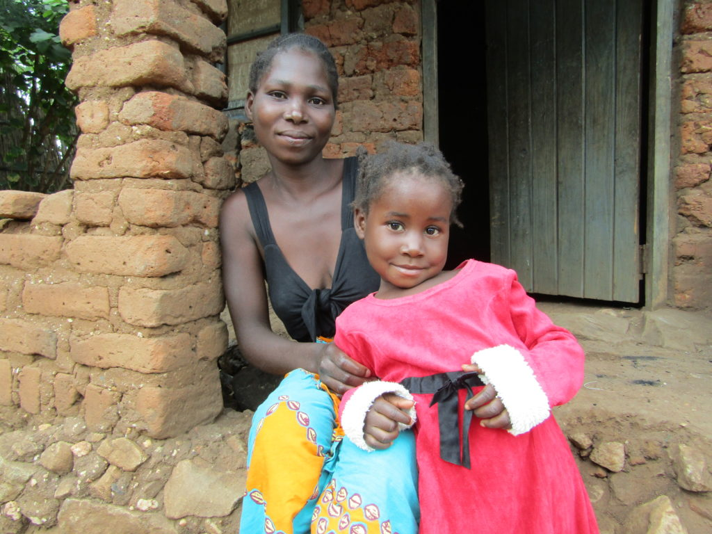 Mercy and her mum at their home